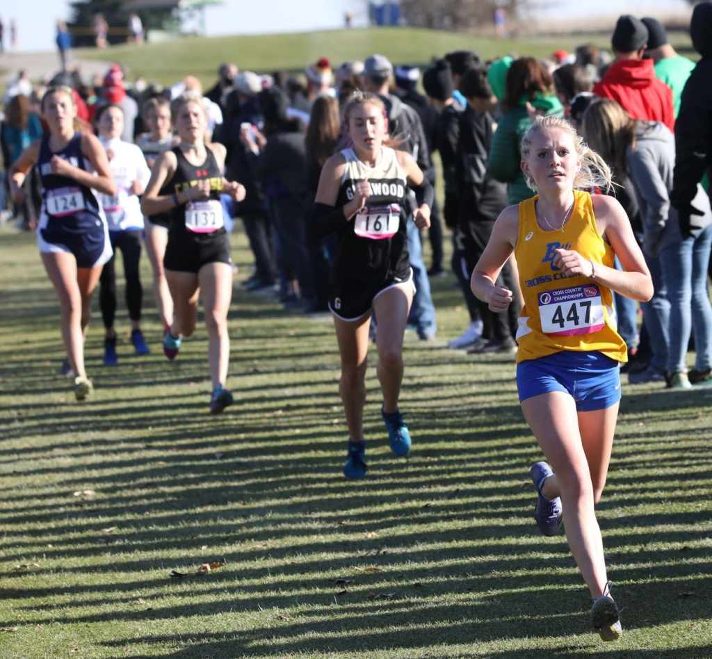Hailee Ricklefs runs at the state cross country meet for Benton Community. Photo by CJ Eilers.